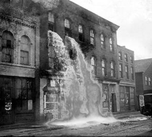 37-Illegal-alcohol-being-poured-out-during-Prohibition-Detroit-1929